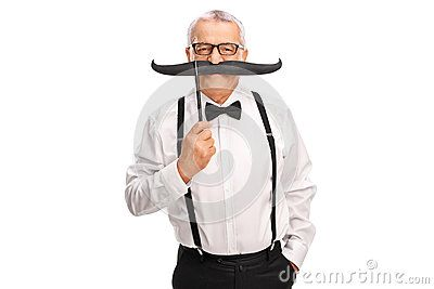 Elegant Mature Man Holding A Fake Mustache - Download From Over 50 Million High Quality Stock Photos, Images, Vectors. Sign up for FREE today. Image: 62101209