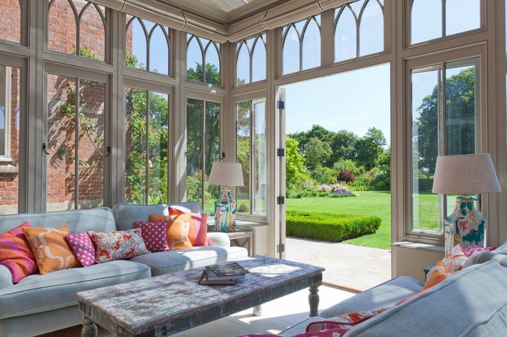 This simple view over the grass, lawn and garden is stunning. Complex Conservatory on Victorian Rectory by Vale Garden Houses