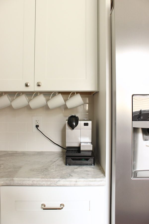 Hang mugs on hooks underneath your cabinets to get them out of your cupboards - increasing your space AND showing them off!