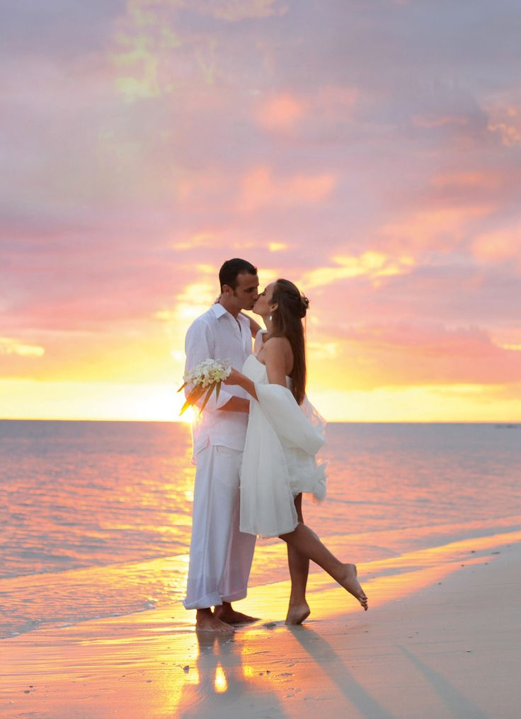 Woman white dress sun setting on beach images