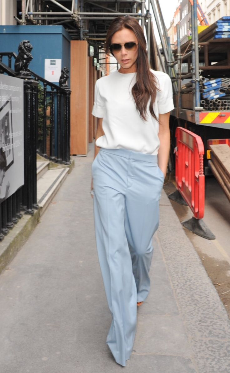 Victoria Beckham white top, blue pants