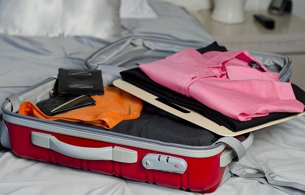 Packing your carry on luggage with ease! Layer your favorite sets of clothes for easy finding and unpacking!