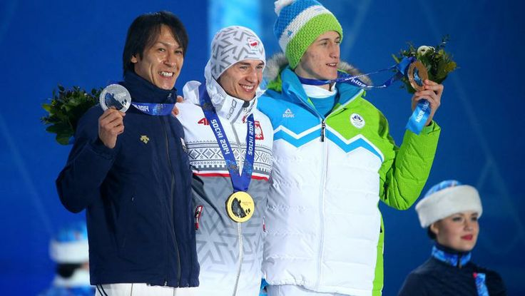 Silver medalist Noriaki Kasai of Japan, gold medalist Kamil Stoch of Poland and bronze medalist Peter Prevc of Slovenia celebrate on the podium during the Medal Ceremony for the men''s ski jumping large hill (120m hill) individual.