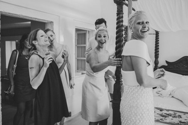 Bridesmaids in action| Image by Sam Hurd | Stella And Moscha Exclusive Greek Island Weddings #weddingportrait #santoriniphotographer #santoriniwedding #santoriniflorist #stellaandmoscha #santoriniweddingplanner