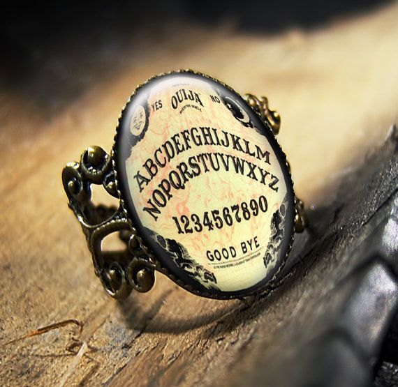 How cool is this ring for Halloween or anytime! (Ouija Board Halloween Horror Glass Bronze Ring by KasketKustoms )