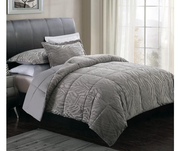 Bring a touch of the wild side into your bedroom. This mink fleece comforter has a zebra pattern embossed into the material for added surface texture. The comforter reverses to a coordinating silver/platinum solid color.