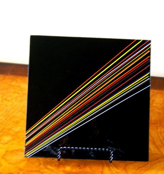 Fused Glass art plate. Jet black background with vibrant stringers in every color of the rainbow. A dramatic effect, a piece of art, serving