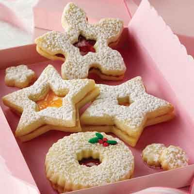 These tender Linzer cookies are a holiday tradition in Austria. The decorative cut-out on the top cookie allows the filling to peek through.