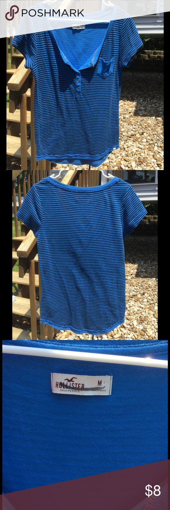 Hollister Blue and Black Striped Top 73% cotton, 26% polyester, and 1% elastane.  Nice summer shirt!  Great with jeans and shorts! Hollister Tops Tees - Short Sleeve