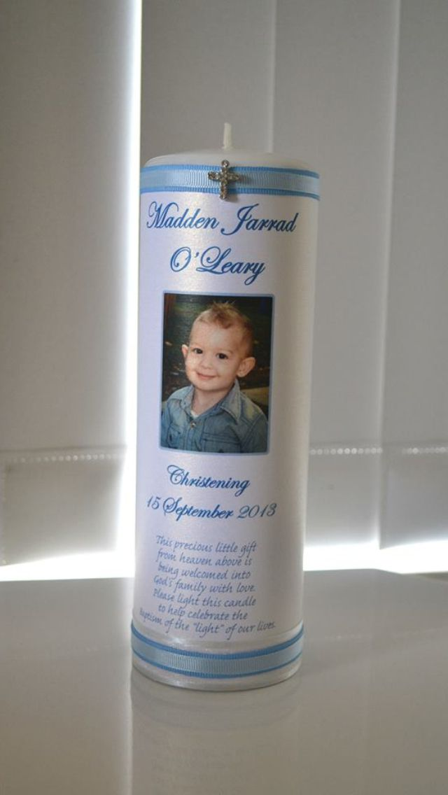 Photo Christening / Naming Day Candle custom design by Flickering Moments. This has a gorgeous blue ribbon trim and includes a diamanté cross . Can be personalised to include any name and date.