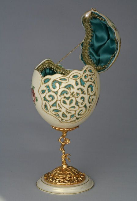 This Ostrich egg is beautifully carved on all sides and embellished with three floral waterslide transfers.