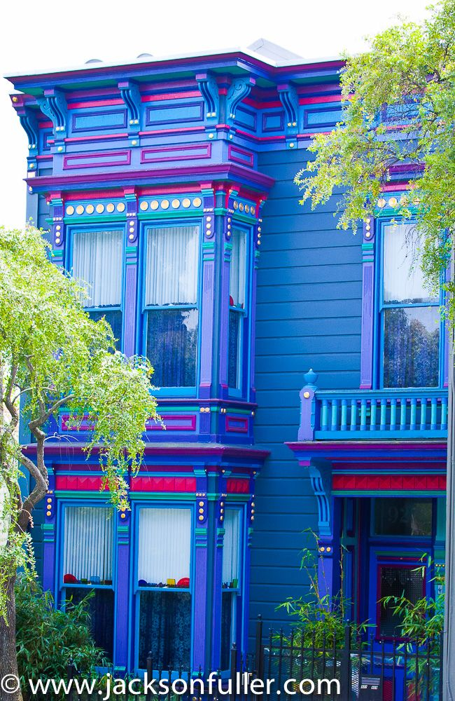 brightly painted San Francisco home  I don't know if I would ever do something like this but I love the way this looks and the idea of it.