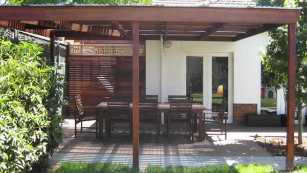 This pergola structure incorporates spotted gum rafters and slats and laminated merbau posts