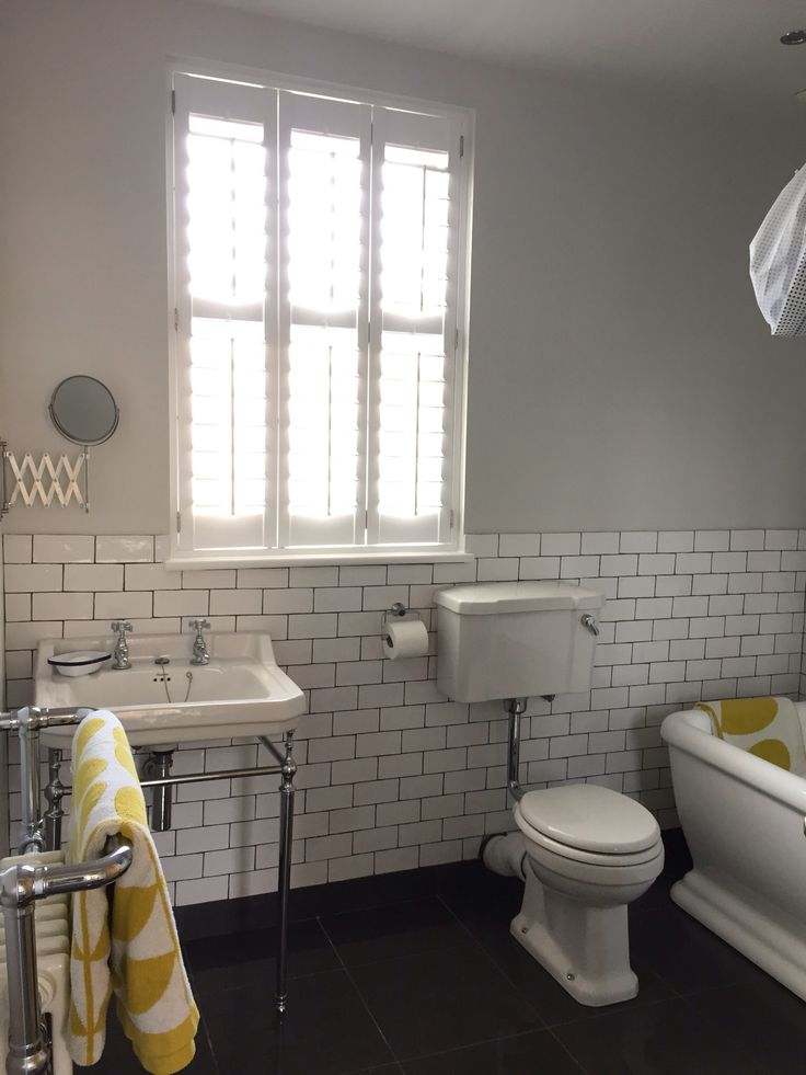 """Newly painted bathroom in Valspar's """"Modern Grey"""" White Metro Tiles with Orla Kiely Towels for a pop of colour."""