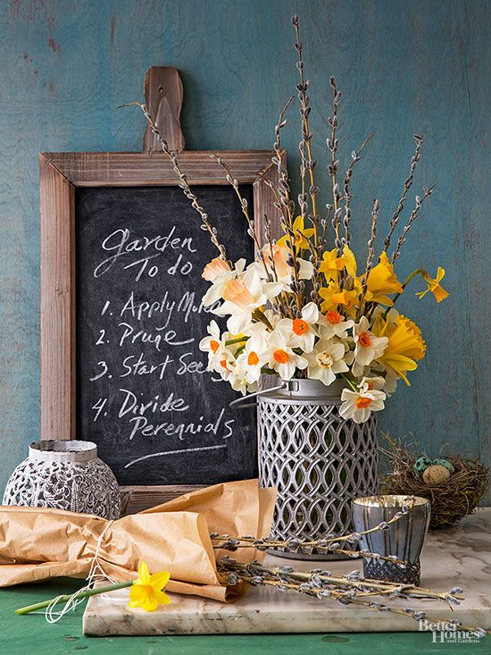 Accentuate classic Daffodils by pairing with twigs and a complementing flower, and arrange in a vintage metal container for a finessed rustic feel.