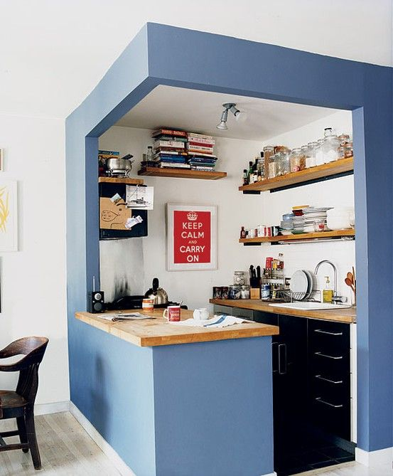 I like how they painted the outer walls of the kitchen but left the walls in the kitchen white. Nice way to divide a small space.