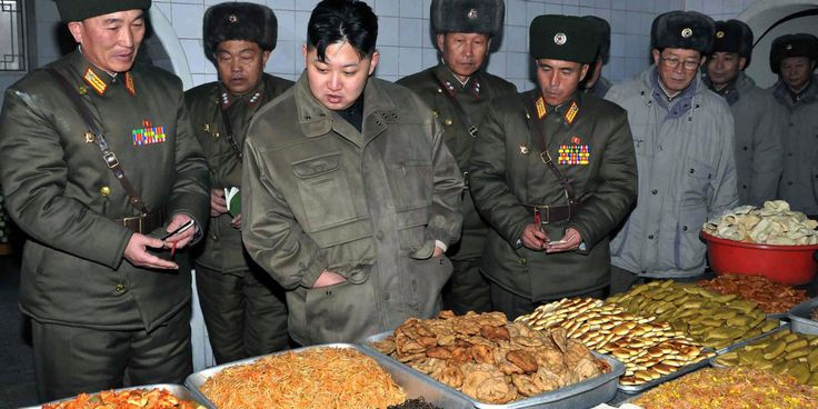 Kim Jong-un looking over the splendor of food while the citizens of his country suffer from hunger and poverty daily.