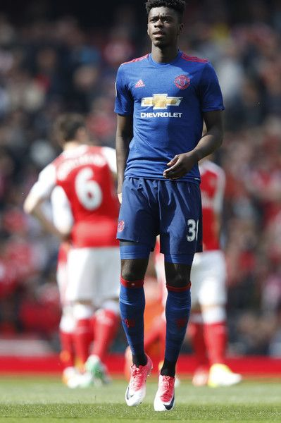 Manchester United's DR Congo-born defender Axel Tuanzebe warms up before the English Premier League football match between Arsenal and Manchester United at the Emirates Stadium in London on May 7, 2017.  / AFP PHOTO / Adrian DENNIS / RESTRICTED TO EDITORIAL USE. No use with unauthorized audio, video, data, fixture lists, club/league logos or 'live' services. Online in-match use limited to 75 images, no video emulation. No use in betting, games or single club/league/player publications.  /