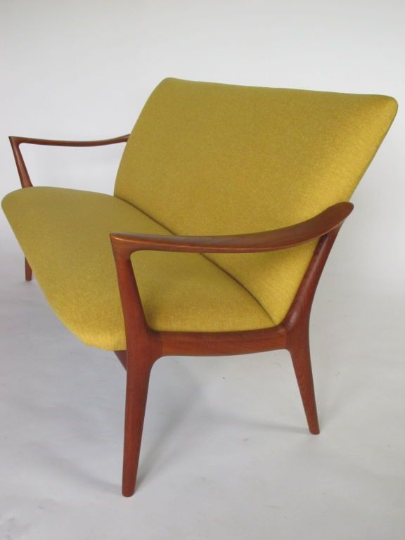 """A Sculptural Teak Settee designed by Rastad and Relling Norway known as """"Bambi"""". 1950s. Norway"""