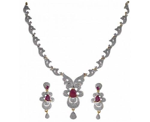 Two toned ,well defined American Diamond Studded necklace from the Jewel house of REJEWEL is one of the master pieces of the brand.Skilful crafted to give the X-Factor look on you with the red CZ stone in the pendant. Can Be worn with any Indian or Western Outfit.A must have collection.