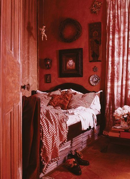 red walls, red and white bedding, red and white curtains... the reds are all muted and deep enough that this room feels relaxing, as opposed to overwhelming