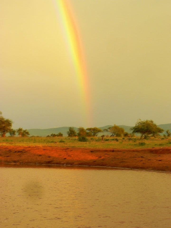 Rainbow over Shaggadonyi Dam by Rob Harte, entry into Lions Bluff photo competition #Tsavo #Kenya #rainbow #scenic  www.lionsblufflodge.com/pages/win.html