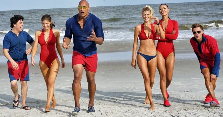 Dwayne Johnson Introduces His Squad in New 'Baywatch' Photo -- Dwayne Johnson, Zac Efron, Alexandra Daddario, Ilfenesh Hadera, Kelly Rohrbach and Jon Bass gather for an epic photo on the 'Baywatch' set. -- http://movieweb.com/baywatch-movie-dwayne-johnson-cast-photo/