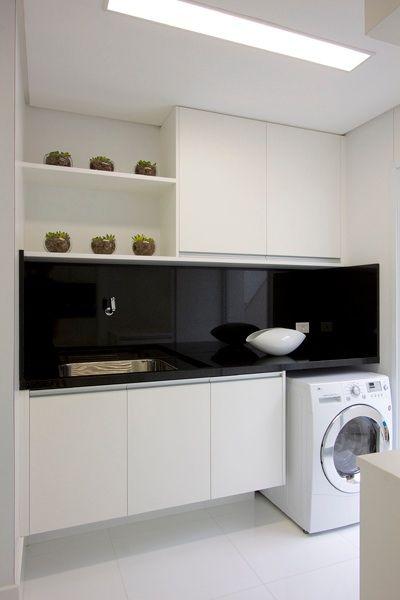 All white laundry with black glass splashback. #laundry #white #glasssplashback