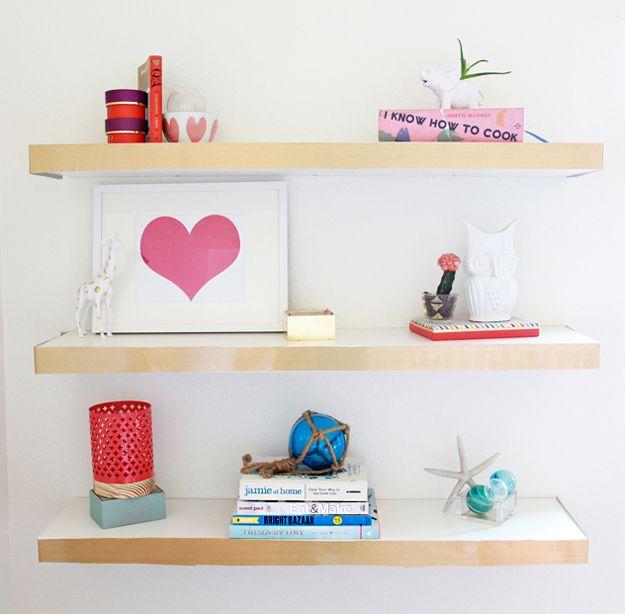 DIY Gold trimmed floating shelves   18 Cool Shelves for Room Decor on a budget   http://diyready.com/diy-room-decor-ideas-for-renters/