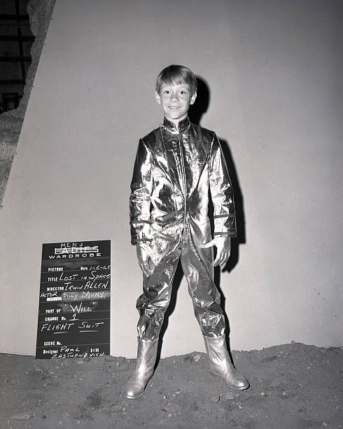 American child actor Bill Mumy as Will Robinson models a flight suit for the television series 'Lost in Space' 6th January 1965 The suit was designed...