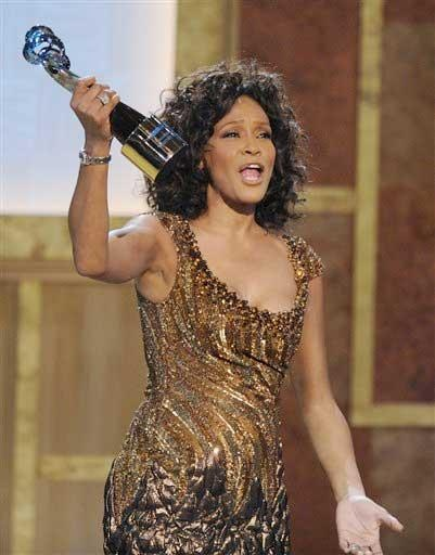 Jan. 16, 2010: Whitney Houston accepts an award at the Warner Theatre during the 2010 BET Hip Hop Honors in Washington, D.C. (AP Photo/Nick Wass)