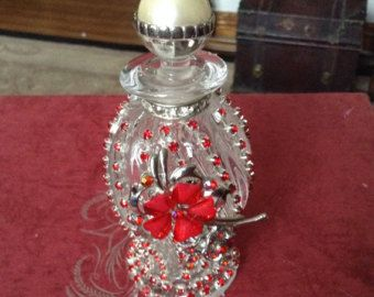 Jeweled red perfume bottle 6 inches high