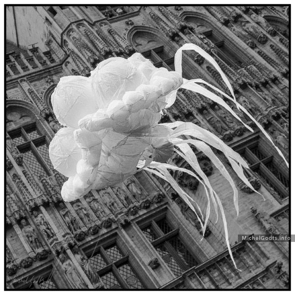 During the 2012 Zinneke parade, a jellyfish balloon floats in front of the Brussels Town Hall (Belgium). Signed or unsigned original black and white photography for art collectors or for a wall decor.