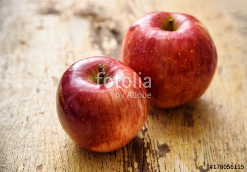 """Download the royalty-free photo """"Bio red apples on rustic wooden background. Autumn fruits"""" created by stillforstyle at the lowest price on Fotolia.com. Browse our cheap image bank online to find the perfect stock photo for your marketing projects!"""
