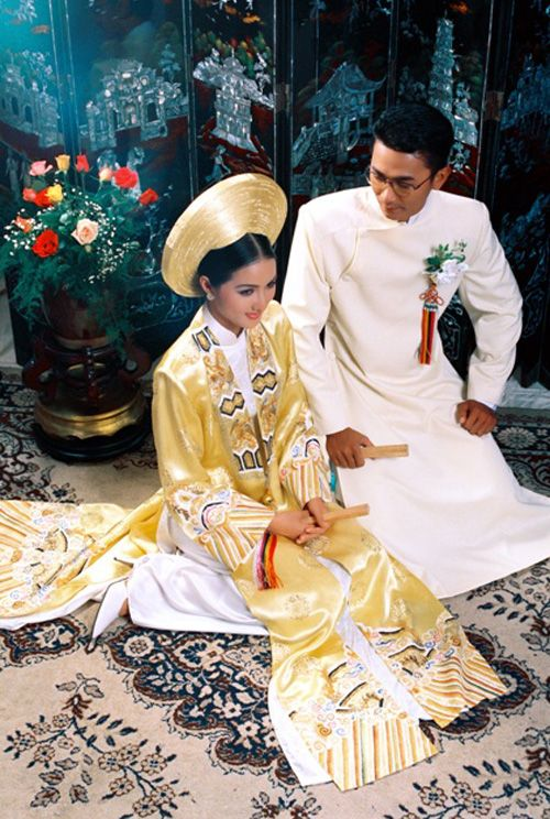 Vietnam:  Traditional wedding attire http://viaggi.asiatica.com/