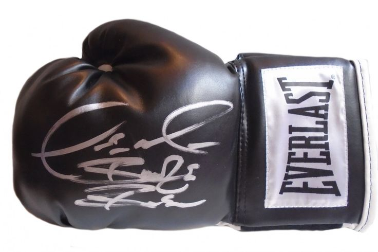 """Deontay Wilder Autographed Everlast Black Boxing Glove w/ Inscription, Proof Photo. WBC World Heavyweight Champion Deontay Wilder Signed Everlast Boxing Glove w/ """"Bronze Bomber"""" Inscription, Proof This is a brand-new Deontay Wilder autographed Everlast left-handed boxing glove featuring """"Bronze Bomber"""" inscription! Deontay signed the glove in silver paint pen. Check out the photo of Deontay signing for us. ** Proof photo is included for free with purchase. Please click on images to enlarge…"""
