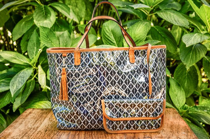 Nicole Martine MalaBar Tote - Water repellent black and white fabric with genuine tan leather handles and trim. Press stud closure, removable tan leather tassel and matching inner purse. www.nicolemartine.com/shop