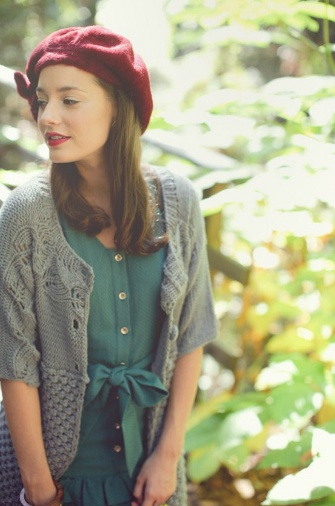 While I probably wouldn't wear the hat, I love the sweater (color and style) paired with the pretty green top or dress.