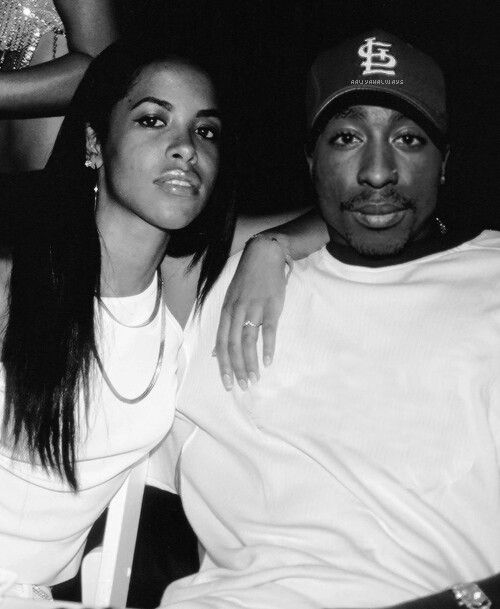 Aaliyah and Tupac..pac rocking the stl hat