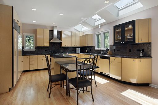 Kitchen in modern home with three skylights