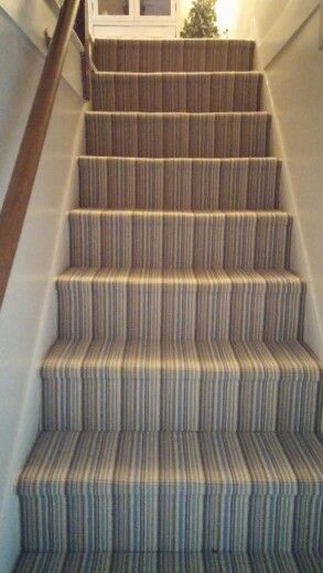 Homespun wool striped carpet used on stairs and hall