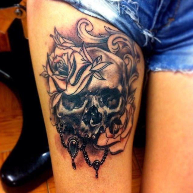 Skull tattoo: thigh piece. Too cute!