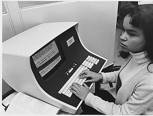 No original caption. [African-American woman computer operator], 1972 - 1991