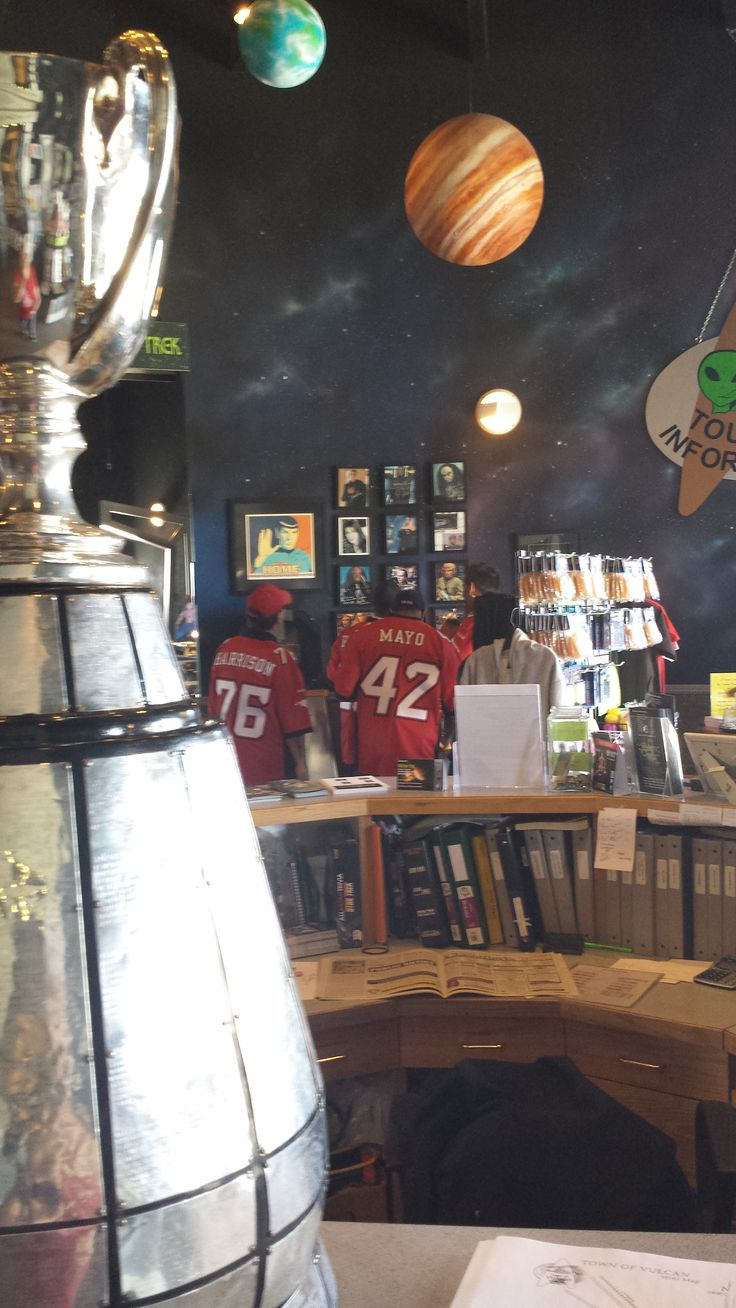 The Grey Cup was brought to Vulcan by three members of the Calgary Stampeders