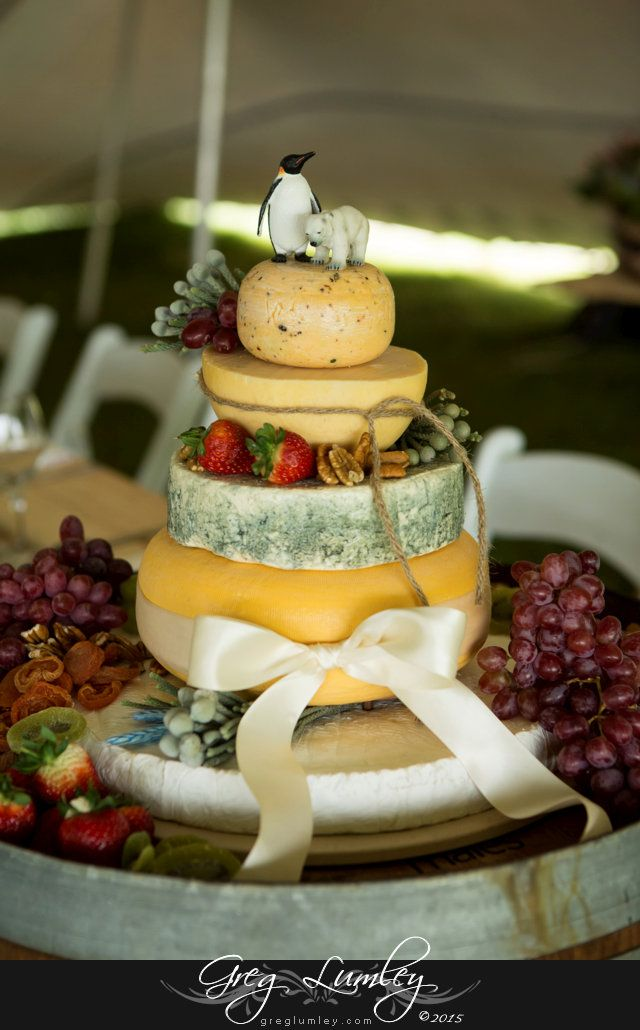 458_coni_f_00005--0.jpg  | Wedding Cake.  Cheese Cake with cape toppers.