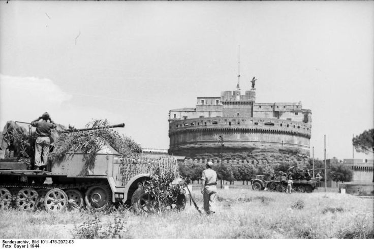 "Italy, Rome, 1943 - Two medium half trucks Sd.Kfz 7/2 with 3,7 cm Flak anti-aircraft guns in front of Castel Sant'Angelo. The Germans moved fast to control the Italian capital after Italy capitulated -- and in the process they attacked and ""neutralized"" the Italian troops in or around Rome."