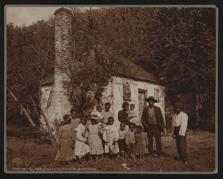 Family posed outside former slave quarters at Hermitage ...