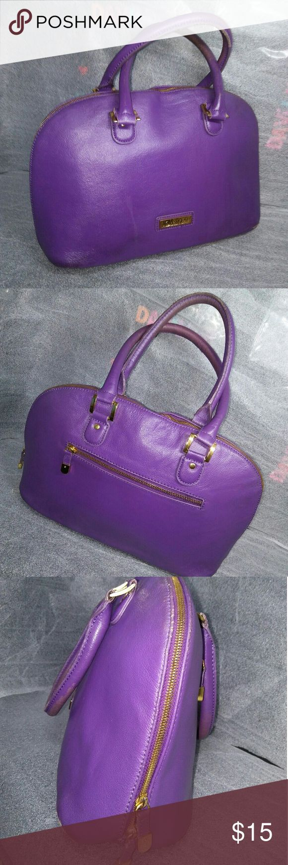 joy and iman drum handbag Ladies and gentlemen, we have Michael kors in the 70s . ... (Joke) this is a joy and man handbag . Has wear on straps , Color is still strong,Zipper glides smoothly and the inside is  satin.shell is Genuine leather . Bags Totes