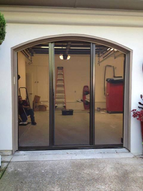 these screens work beautifully with a curved garage door header as seen in a brown frame