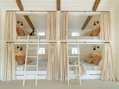 This post has many ideas for multiple twin beds in the same room.  I love this one with the curtains.